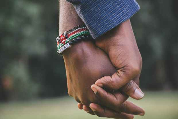 close up photo of two person s holding hands